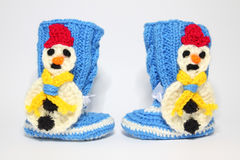 Knitted woolen bootees for young children. Warm knitted woolen bootees for toddlers Stock Images