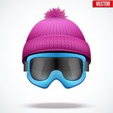 Knitted woolen cap with snow goggles. Winter Stock Photos