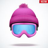 Knitted woolen cap with snow goggles. Winter Stock Photography