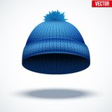 Knitted woolen cap. Winter seasonal blue hat. Stock Image