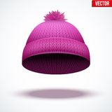 Knitted woolen cap. Winter seasonal pink hat. Stock Photos