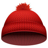 Knitted woolen cap. Winter seasonal red hat Royalty Free Stock Image