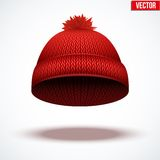 Knitted woolen cap. Winter seasonal red hat. Royalty Free Stock Image