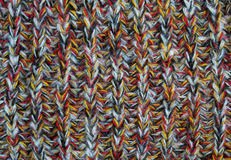 Knitted woolen fabric of colored yarn royalty free stock photo