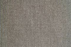 Knitted woolen fabric of gray brown color Stock Photography