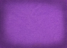Knitted woolen fabric purple. wool texture. Stock Photos