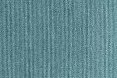 Knitted woolen fabric of turquoise color Stock Images