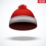 Knitted woolen red cap. Winter seasonal blue hat. Royalty Free Stock Photo