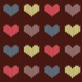 Knitted woolen seamless pattern with colored hearts on a brown background. Valentine`s Day stock illustration