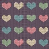 Knitted woolen seamless pattern with colored hearts on a vintage purple background. Valentine`s Day vector illustration