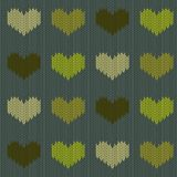 Knitted woolen seamless pattern with hearts in green tones on a coniferous green background. Valentine`s Day Royalty Free Stock Photos