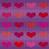 Knitted woolen seamless pattern with pink hearts on a violet background. Valentine`s Day Stock Photography