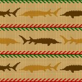 Winter Knitted woolen seamless pattern with sturgeons in vintage beige tones. Knitted woolen seamless pattern with sturgeons in vintage beige tones Royalty Free Illustration