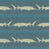 Winter Knitted woolen seamless pattern with sturgeons in vintage blue tones. Knitted woolen seamless pattern with sturgeons in vintage blue tones stock illustration