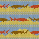 Winter Knitted woolen seamless pattern with sturgeons. Yellow sand and blue water. Knitted woolen seamless pattern with sturgeons. Yellow sand and blue water Royalty Free Stock Photos