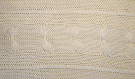 Knitted woolen texture. Knitted pattern royalty free stock photo