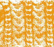 Knitted woolen texture orange Royalty Free Stock Images