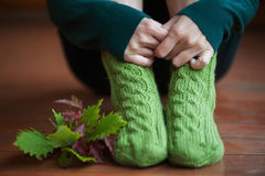 Knitted woolen warm socks with leafs Stock Photos