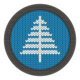 Knitted xmass tree on frame blue. Knitted Christmas tree pattern vector. Flat cartoon illustration. Objects isolated on white background Royalty Free Stock Images