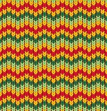 Knitter seamless pattern with stripes and zigzag. Colorful texture, vector background. Retro seamless pattern with orange, pink, green and violet colors Stock Images