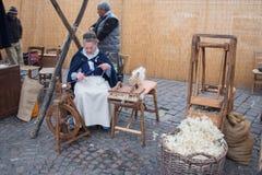 Knitter women. Craftsmen market in Bologna. Tuscany, Italy. Royalty Free Stock Photography