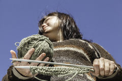 Knitter. The young woman holding a knitting equipment. Point of view form below Royalty Free Stock Photos