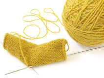 Knitting 1. Clew of the wool threads and the knitting pattern Stock Photo