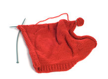 Knitting. A sweate in the progress of being knitted, shot against a white background Royalty Free Stock Photography