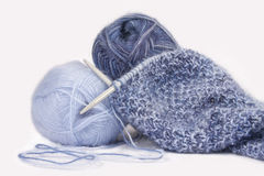 Knitting. With blue fluffy wool, on  needles Royalty Free Stock Photography
