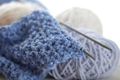 Knitting. With blue wool, on  needles and balls; shallow DOF as arts effect Royalty Free Stock Photo