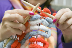 Knitting. Hands of a young woman on a knitting project Royalty Free Stock Photography