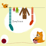 Knitting. Red cat knit socks, gloves and sweaters Royalty Free Stock Image