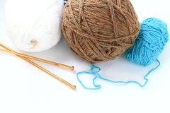 Knitting. Image of three balls of woolen yarn and knitting needles Stock Images