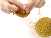 Knitting. Hands with knitting close-up Royalty Free Stock Images