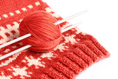 Knitting. Skein of wool and knitting needles on the finished thing Stock Photography