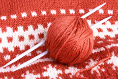 Knitting. Skein of wool and knitting needles on the finished thing Royalty Free Stock Images