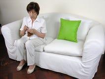Knitting 5. An elder woman knitting wool Royalty Free Stock Photo