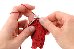 Knitting. Hands of a young woman knitting Royalty Free Stock Image