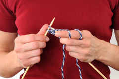 Knitting. Hands of a young woman knitting Royalty Free Stock Photo