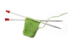 Knitting. Pattern, needles on a white background Stock Image