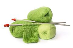 Knitting. Coils Green Moher and the sample connected knitting needles Stock Photography