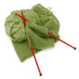 Knitting. Yarn and red needles, with scarf inprogress.  Green mohair wool Stock Images
