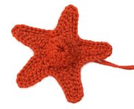 Knitting. It is knitted starfish isolated on white background Stock Image