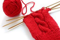 Knitting A Red Yarn Ball With Noodles Royalty Free Stock Images