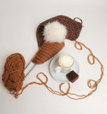 Knitting accessories and cup of cappuccino. Knitting accessories and cup of coffee with chocolate Stock Photography
