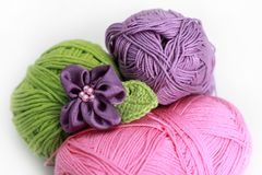 Knitting accessories - three skeins on white Royalty Free Stock Photos