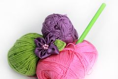 Knitting accessories - three skeins on white Stock Photo