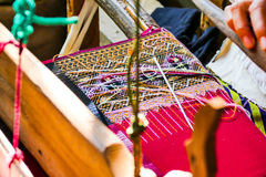 Knitting with ancient tools. Requires a lot of skill to get beautiful fabrics Royalty Free Stock Images