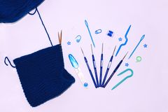 Free Knitting And Crocheting Flatlay.Blue Yarn Skein, Crochet Hook, Row Counter On White Background Isolated.Knit Hat Process Royalty Free Stock Photography - 167550157