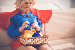 Knitting as superwoman Royalty Free Stock Images